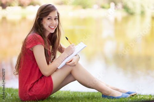 Female with workbook outdoors