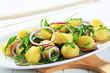 Potatoes with arugula and onion