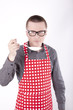 Male cook in the apron with kitchen tool