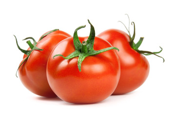 Ripe red tomatoes on a white background