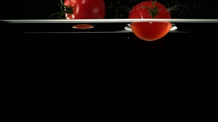 Fresh tomatoes in water, Slow Motion
