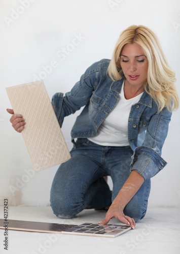 Young woman choose tiles
