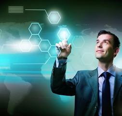 Businessman pressing high tech buttons on a virtual touchscreen