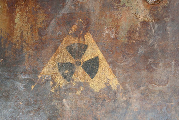 Radiation hazard sign on the rusty iron surface