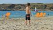 Boy playing on the beach. Yoga
