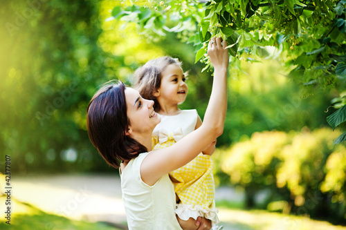 woman and child under tree