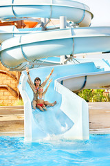 Child with mother  at aquapark.