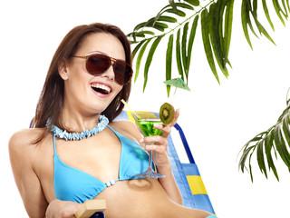 Woman under palm tree.