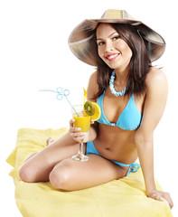 Girl in bikini drink juice through straw.