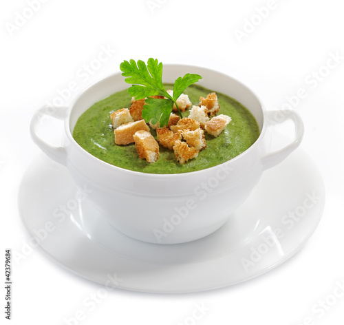 Cream soup with dried crusts isolated on white, studio shot