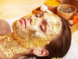 Woman getting  facial mask .