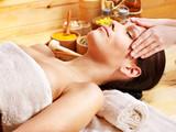 Fototapety Woman getting  facial massage .