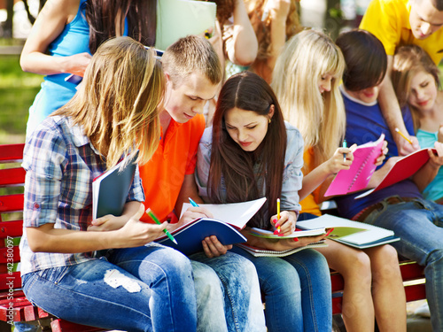 Group student with book outdoor.