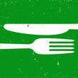 Cutlery on green background