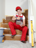 Apprentice for building sector at work shows thumb up