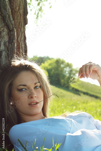 woman laying under the tree