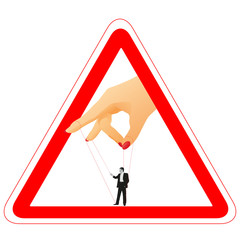 Warning sign with woman`s arm holding a businessman for a thread