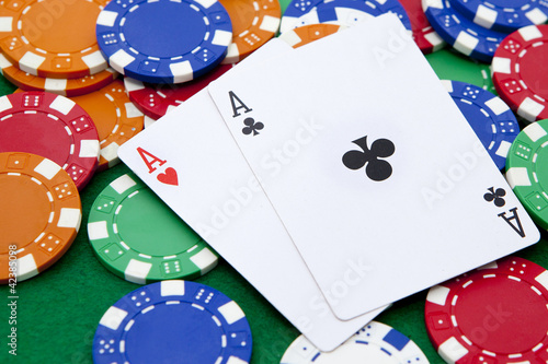 pocket aces on a casino table