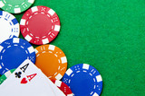 Texas holdem pocket aces on casino table with copy space and chi