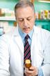 Pharmacist holding pills