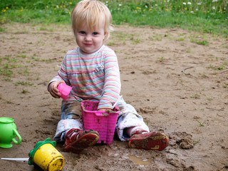 Dirty baby play with sand