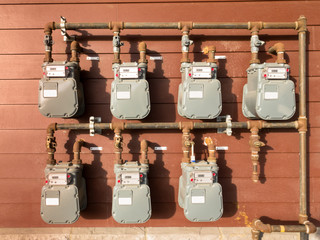 Natural gas meter bank on outside building wall