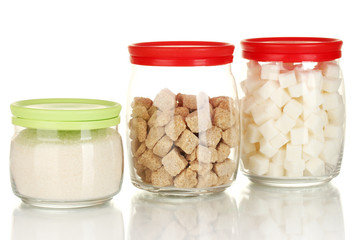 Jars with brown cane sugar lump, white crystal sugar and white