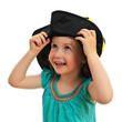 Smiling little girl in hat, isolated on white