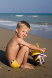 A little boy on a beach (games with sand)