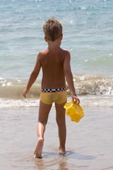 A child follows sea water