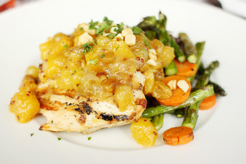 Charbroiled chicken breast with pineapple macadamia nut chutney.