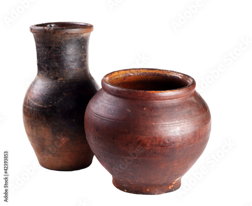 Old Earthenware Jugs isolated on white background