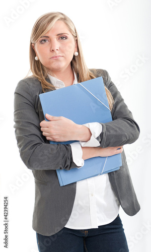 Serious young woman with file