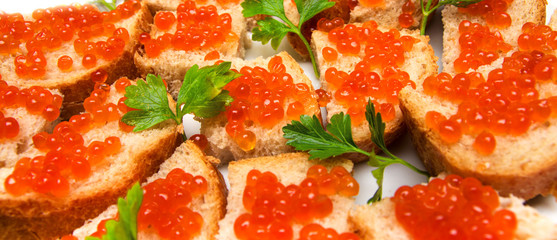 red caviar on bread with parsley