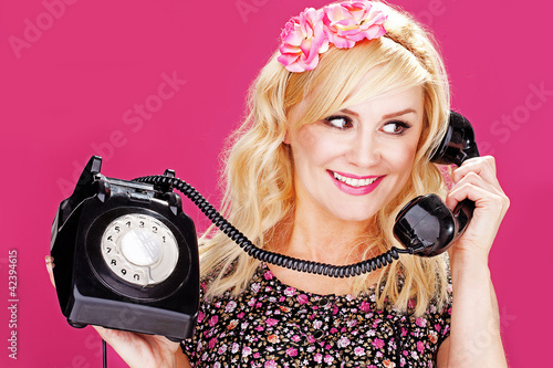 Woman talking on old telephone
