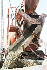 pouring concrete into barrel