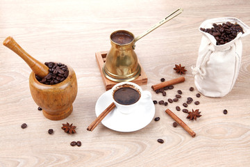 black arabic coffee served with accesories on table