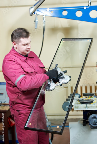 glazier worker with glass