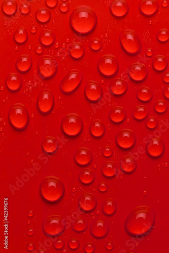 Water bubbles on red background