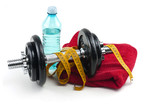 dumbells, water in bottle and towel on white background