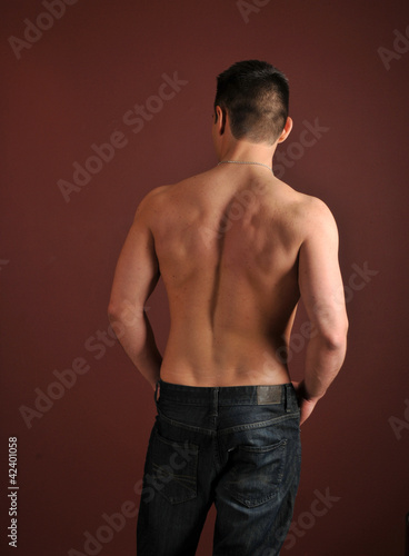 Shirtless man in blue jeans