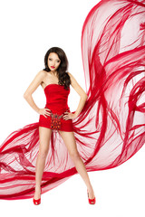 Beautiful woman standing in red flying dress. Hands on hips. Chi