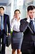 Businesspeople calling