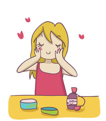 giovane donna bionda si spalma la crema idratante sul viso