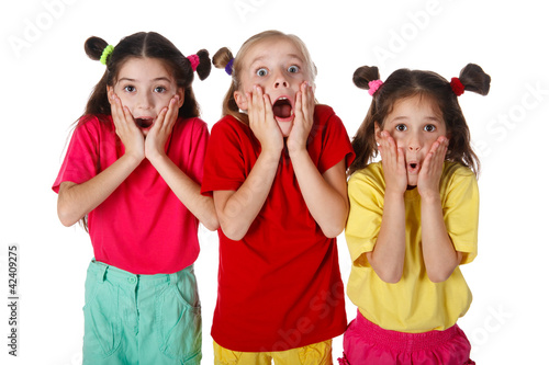 Three surprised little girls