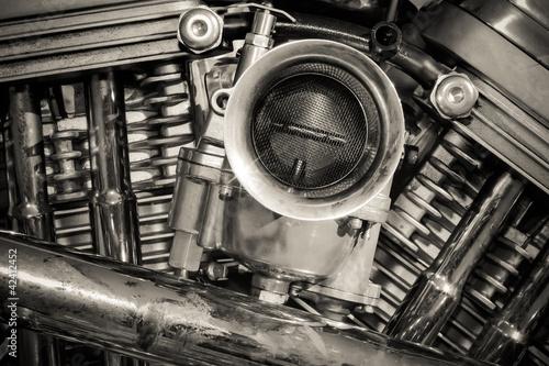 sepia toned chromed motorcycle engine
