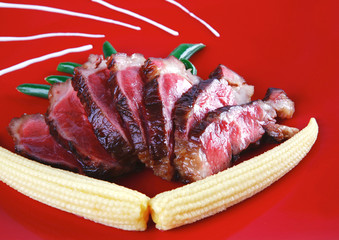 beef meat served with corns