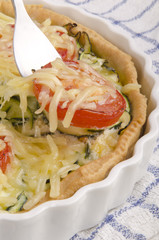 freshly made zucchini quiche with tomato