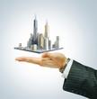 Business city center on businessman hand