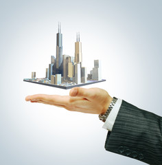 Business city center on businessman hand